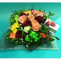 Flower arrangement on tray. Multi color roses combination