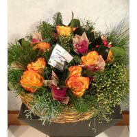 Christmas flowers in wreath basket