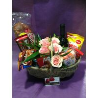 Flower arrangement in basket with Easter Gourmet Delicacies !