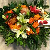 Christmas Arrangement Tropical Flowers & Candle & Decoration.