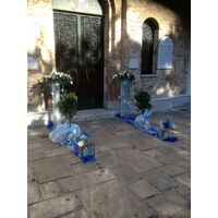 Arrow  shaped arrangements , Olive Plants (balls) and Candles