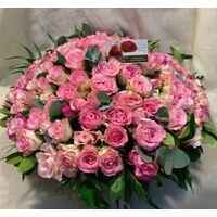 Pink Roses (100) stems round basket arrangement