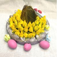 Yellow roses in glass with assorted Easter decoration
