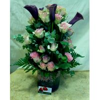 Arrangement In Glass Vase. Purple Flowers With Decorative Flower Gel.