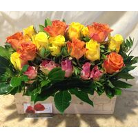 Mixed colored roses in wooden pot. (21) stems.