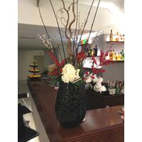 Exclusive arrangement in design vase.