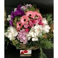 "Exclusive ""Ball Shape"" arrangement in basket."