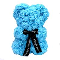 "Roses Teddy Bear. Dim. 25cm. In ""Decorative Package "". (1)piece. Blue, Pink, Red, White."
