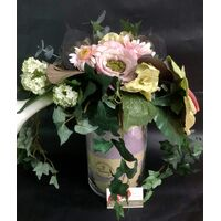 Artificial Flower Arrangement In Glass Cylinder Vase (Height 30cm - Diam.16cm) with decorative colored sand internal layers.