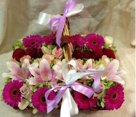 Flat basket 45cmx30cm with flowers in parallel rows.Summer flavor.