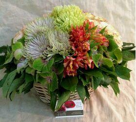 Multi colored flowers in basket