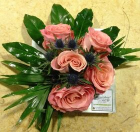 Arrangement with vanda orchids or roses in zink tray