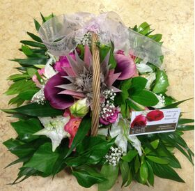 Small basket with blue colored sprayed roses arrangement.New Born Boy or Girl.(pink)