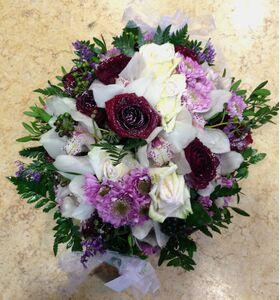 """Ανθοπωλείο flowershop.gr Χειμώνας λουλούδια σε """"Χιονισμένο"""" καλάθι. Στρογγυλό."""