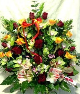 Basket with roses and cymbidium orchids