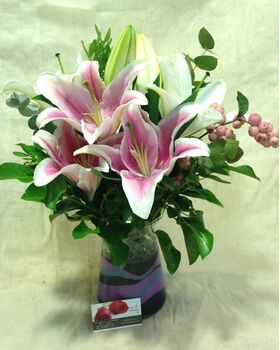 Lillies in Glass Vase with Colored Decorative Sand