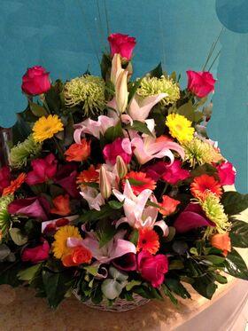 Basket arrangement  with season summer flowers