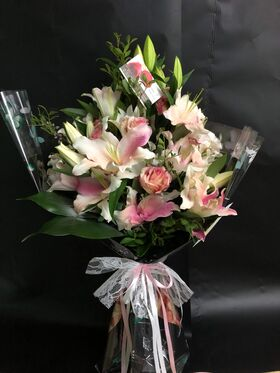 Pink or white lilies oriental bouquet.Exclusive.