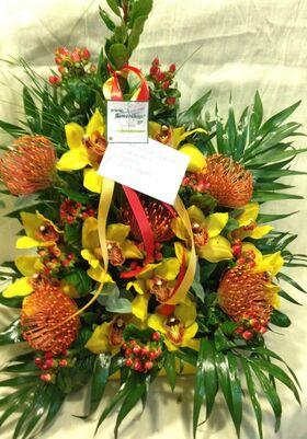 Vase with phalaenopsis or vanda or cymbidium orchids