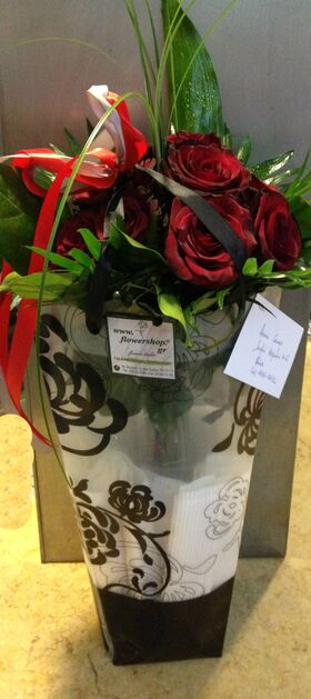 Red roses bouquet (10)stems  A' quality Dutch  gift wrapped with greens in water!!!